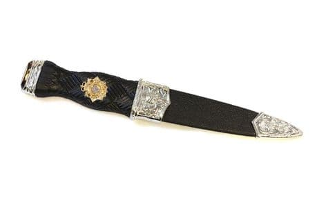 Scottish Transport Regiment   A one-piece safety sgian dubh in the formal dress design, featuring the Scottish Transport Regiment cap badge. This sgian dubh has no blade and can be shipped worldwide.