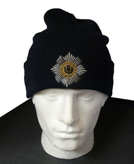 The Scots Guards - Woollen Beanie Hat featuring the cap badge of the scots guards.